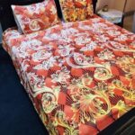 Orange Printed Bed Sheet With 2 Pillow Covers – 3 PCS